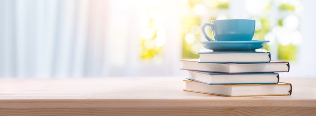 stack book and cup of coffee on wooden table