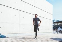 Sporty Guy Jogging In Urban Street