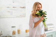 Happy Woman Smelling Bouquet O...