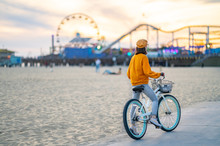 Young Woman With Bike On Santa Monica Beach