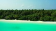 hidden gazebo in the tropical palm forest, turquoise water and beaches in Maldives.