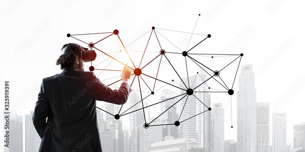 Fototapeta Handsome businessman experiencing impressive virtual reality connection concept