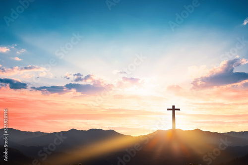 Silhouette cross on mountain sunset background Wallpaper Mural