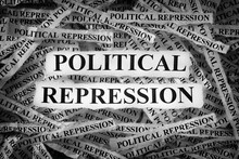 Strips Of Newspaper With The Words Political Repression Typed On Them