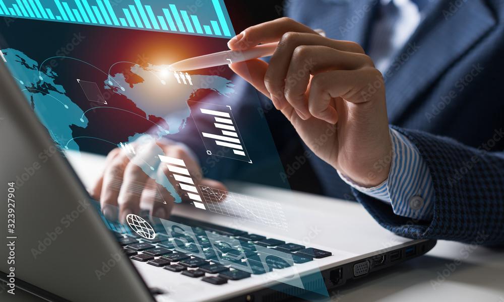 Fototapeta Businessman works with financial data
