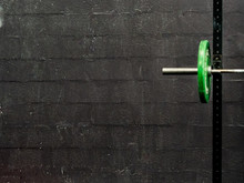 Green Barbells On Black Backgr...