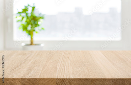 Wooden table top and defocused window background for product display