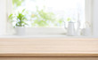 Leinwandbild Motiv Wooden kitchen table with background of window for product display