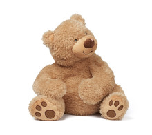 Big Curly Brown Teddy Bear Sits On A White Isolated Background