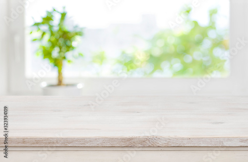 Obraz Bleached table surface on blurred window background with copy space - fototapety do salonu
