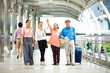 Travel and tourism concept.Group of senior people traveling in the city and looking the map in hand for Shopping Mall Search