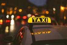 Taxi Sign On Car During Night