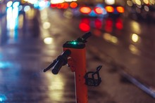 Electric Scooter In Rainy Night