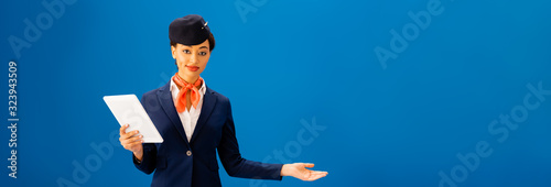 panoramic shot of smiling african american flight attendant holding digital tabl Canvas Print