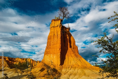 Cuadros en Lienzo Tall rock in the Tatacoa Desert, Colombia under the cloudy sky