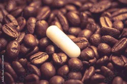 Fotografie, Obraz caffeine pills. pill on the background of coffee beans.