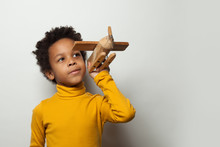 Playful Clever Black Child Boy With Plane Model