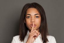 Black Woman With Silence Gestu...