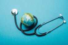 Globe And Stethoscope On Blue ...