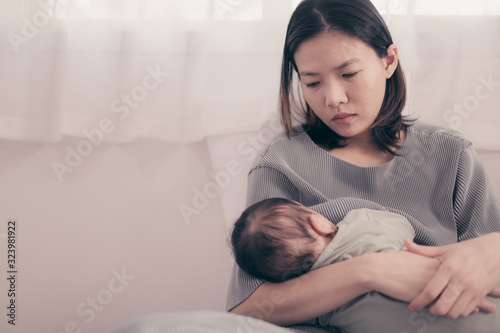 Obraz Tired Mother Suffering from experiencing postnatal depression.Health care single mom motherhood stressful. - fototapety do salonu
