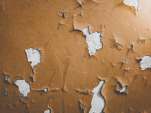 Closeup Toned Photo Of Old Brown Painted Wall With Cracks And Oil Pieces Peeling Off