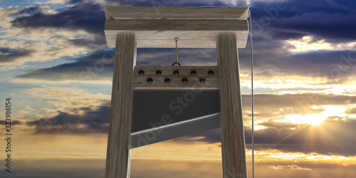 Guillotine against cloudy sky at sunrise background Tablou Canvas