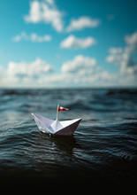 Paper Boat By The Sea