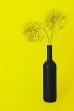 Yellow Still Life With A Bottle Of Wine And Flowers On A Yellow Background