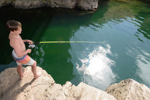 Boy Fishing In A Mountain Rive...
