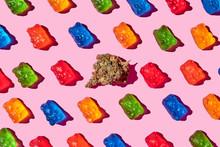 Recreational Marijuana With Gummy Bears On A Pink Background