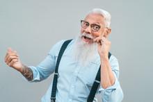 Happy Trendy Senior Man Having...
