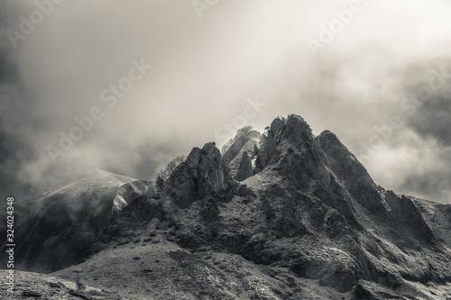 Fototapeta Mysterious black mountain with dramatic cloudy sky obraz