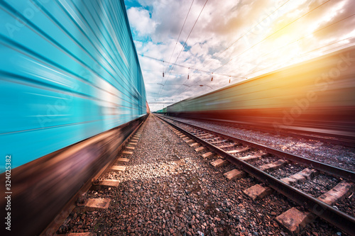 Fotomural railway on which trains move with speed and blur effect