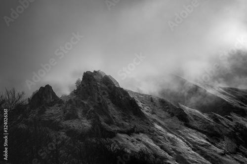 Obraz Mysterious black mountain with dramatic cloudy sky - fototapety do salonu