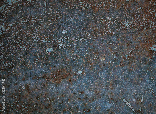 Fotografía Rusty and deteriorated old metal plate texture.