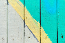 Wooden Fence Painted In White And Turquoise With A Yellow Line. Texture, Background