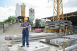 female worker stood on concrete pad on construction site
