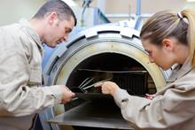 Workers Taking Sheet Metal From Kiln