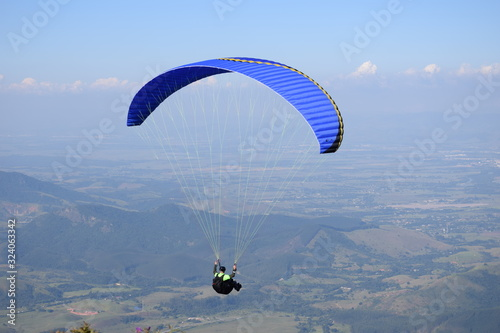 paragliding pilot jumping from a ramp at Pico Agudo, in Santo Antonio do Pinhal Canvas Print