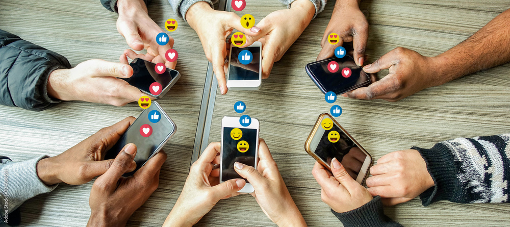 Fototapeta Group of millennial friends using mobile phones - Young people addiction to technology trends following and chatting with emoji on smartphones - Tech and millennial concept