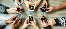 Group Of Millennial Friends Using Mobile Phones - Young People Addiction To Technology Trends Following And Chatting With Emoji On Smartphones - Tech And Millennial Concept