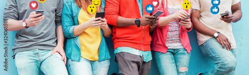 Fototapeta Group of millennial friends using mobile phones - Young people addiction to technology trends following and chatting with emoji on smartphones - Tech and millennial concept - Focus on center hands obraz