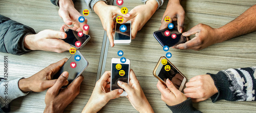 Fototapeta Group of millennial friends using mobile phones - Young people addiction to technology trends following and chatting with emoji on smartphones - Tech and millennial concept obraz