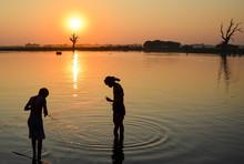 Two Boys Fishing In A Lake At Sunset, Amapura, Myanmar.,Amapura