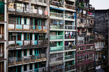 Facade Of Rows Of Run Down Apartment Houses With Washing Hanging On Balconies.,Yangon