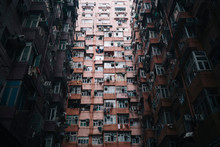 Low Angle View Of Facade Of Towering Residential Complex With Windows And Balconies.,Hong Kong