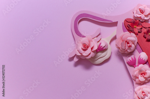Fotografía Womens reproductive system, pink art concept with flowers, close-up, copy space