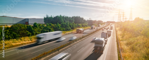 Lots of Trucks and cars on a Highway - transportation concept Fototapeta