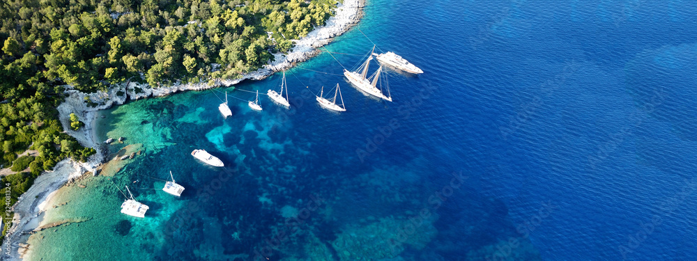Aerial drone ultra wide photo of tropical Caribbean bay with white sand beach and beautiful turquoise and sapphire clear sea