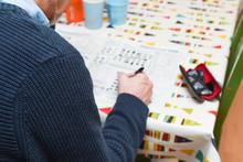 Mature Man Doing A Crossword P...